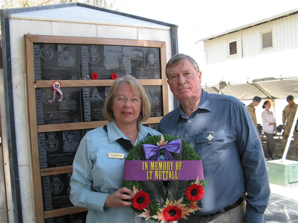 Jane and Rick laying a wreath for Andrew.